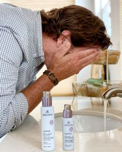 Man Washing face using Arbonne Age Well